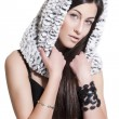 Sexual young woman in white fur hood — Stock Photo