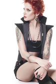 Sexual powerful woman with tattoos and short red hair isolated — Stock Photo