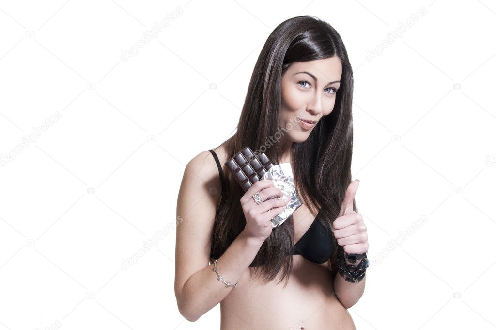 Portrait of an attractive young woman eating a block of dark cgocolate, isolated on white background — Stock Photo #7789087