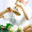 Combing blonde hair — Stock Photo