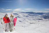 Two happy snowboarders in snow covered mountains — Stock Photo