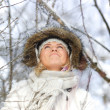 Woman in snowy forest — Stock Photo #7938904