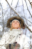 Woman in snowy forest — Stockfoto