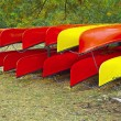 Kayaks rack on shore — Stock Photo