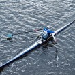Man rowing in boat on water — Stock Photo