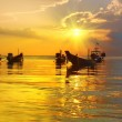 Golden Sunset and longtail boats on tropical beach. Tao island, — Stock Photo