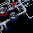 Communication of water meters and taps on a black background — Stock Photo