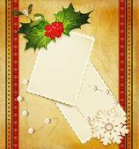 Felicitación de navidad con holly y una tarjeta de felicitación — Vector de stock