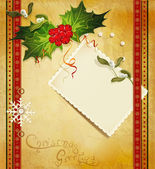 Christmas greeting with holly and a greeting card — Stock Vector