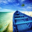 Blue boat on the beach — Stock Photo
