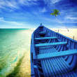 Stock Photo: Blue boat on the beach