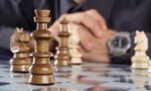 Businessman playing chess — Stock Photo