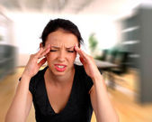 Woman heaving a headache — Stock Photo