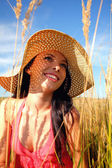 Young woman wearing a sun hat — Stock Photo