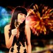 Sexy woman with champagne over fireworks background — Stock fotografie