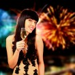 Sexy woman with champagne over fireworks background — Stok fotoğraf