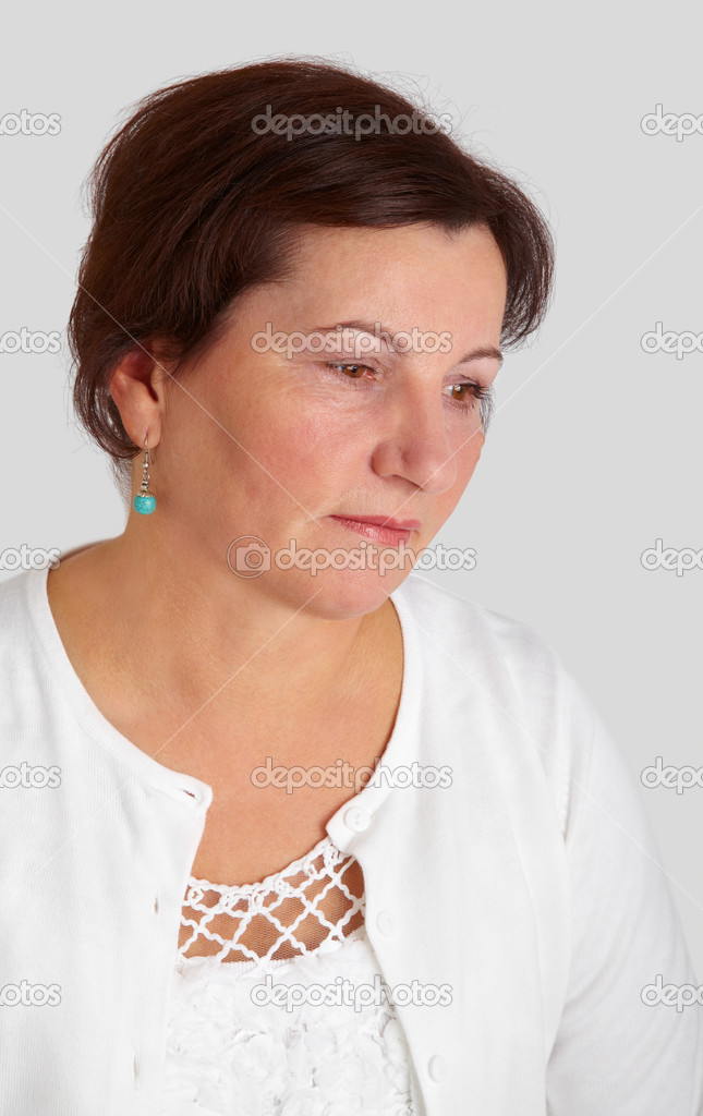 Portrait of a beautiful middle aged woman against a grey background. — Stock Photo #7497407