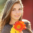Stock Photo: Young woman with flowers