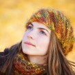 Young woman looking up — Stock Photo