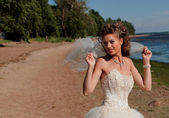The bride on seacost — Stock Photo