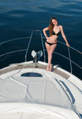 Girl relaxing on a yacht. — Stock Photo