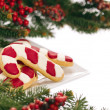 Christmas cookies decorated with real tree branches — Stock Photo