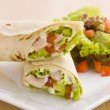 Two avocado wrap with a healthy side salad - Stock Photo