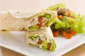 Two avocado wrap with a healthy side salad — Stock Photo