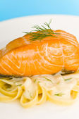 Salmon steak on pasta, decorated with dill closeup — Stock Photo