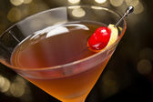 Manhattan cocktail garnished with a cherry and lemon — Stock Photo