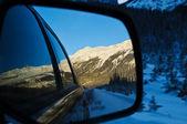 Winter landscape seen through a car mirror — Stock Photo