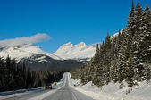 Highway in Winter through mountains — Stock Photo
