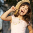 Cute girl is fitting straw hat — Stock Photo #6827501