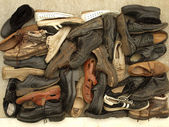 A large number of diverse old shoes — Stock Photo