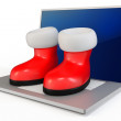 3d santa's boots and laptop - Foto Stock