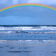 Blue waves and rainbow — Stock Photo