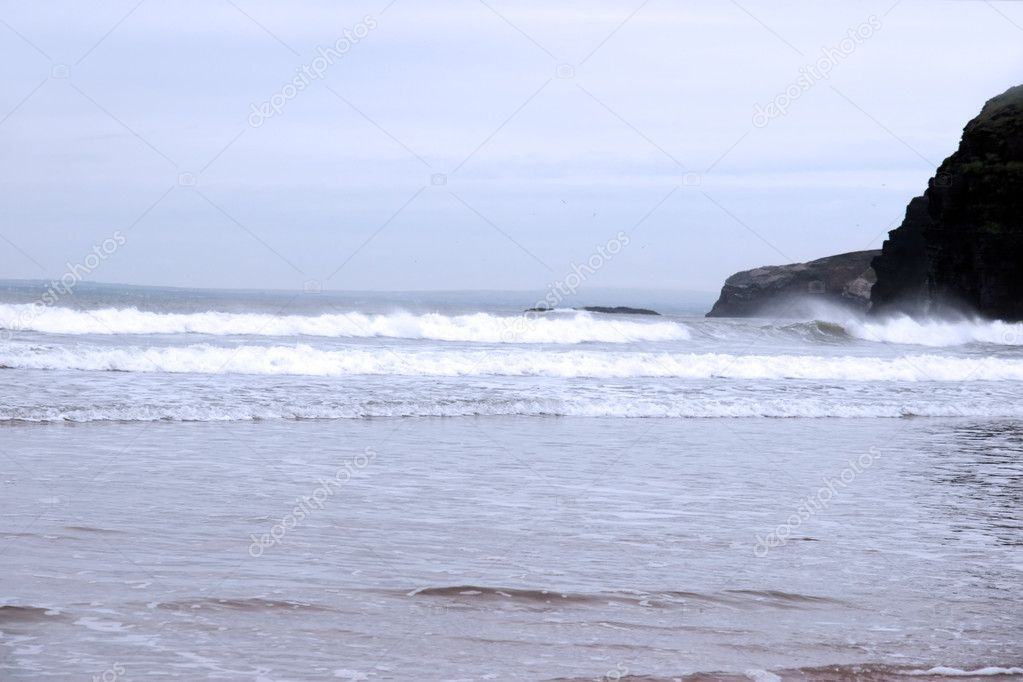 A view of the beach cliffs in ballybunion co kerry ireland on a stormy winter — Stock Photo #6862137