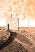 Sepia path to ballybunions old castle ruins — Stock Photo