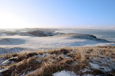 Icy snow covered links golf course and sea — Stock Photo