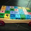 Childrens toy letter building blocks in cart — Stock Photo #7277776
