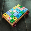 Childrens toy cart and letter play blocks — Stock Photo #7302273