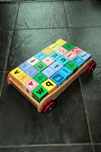 Childrens toy cart and letter play blocks — Stock Photo