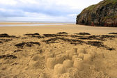 Sandcastles and cliffs — Stock Photo