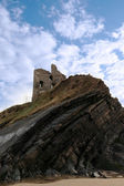 Castle tower on a high layered cliff — Stock Photo