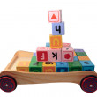 Childrens play letter blocks in toy cart isolated on white — Stock Photo #7613923