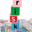 Cash risk in toy play block letters — Stock Photo
