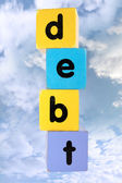 Cloudy debt in toy play block letters with clipping path — Stock Photo