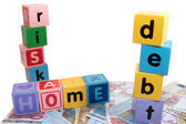 Home debt risk in toy play block letters — Stock Photo
