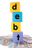 Money debt in toy play block letters — Stock Photo
