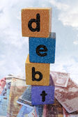 Stormy debt in play letters — Stock Photo